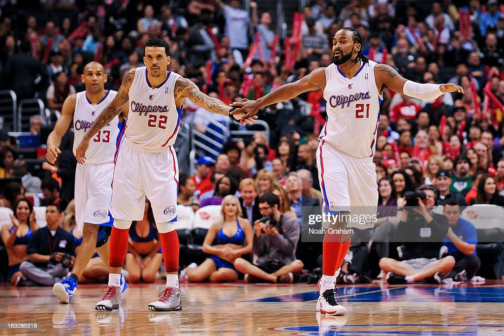 Ronny Turiaf #21 of the Los Angeles Clippers celebrates with teammate Matt Barnes #22 after dunking against the Milwaukee Bucks at Staples Center on March 6, 2013 in Los Angeles, California.