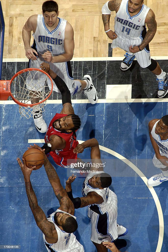 <a gi-track='captionPersonalityLinkClicked' href=/galleries/search?phrase=Ronny+Turiaf&family=editorial&specificpeople=224998 ng-click='$event.stopPropagation()'>Ronny Turiaf</a> #21 of the Los Angeles Clippers fights for the rebound against <a gi-track='captionPersonalityLinkClicked' href=/galleries/search?phrase=Kyle+O%27Quinn&family=editorial&specificpeople=9027719 ng-click='$event.stopPropagation()'>Kyle O'Quinn</a> #2 of the Orlando Magic on February 6, 2013 at Amway Center in Orlando, Florida.
