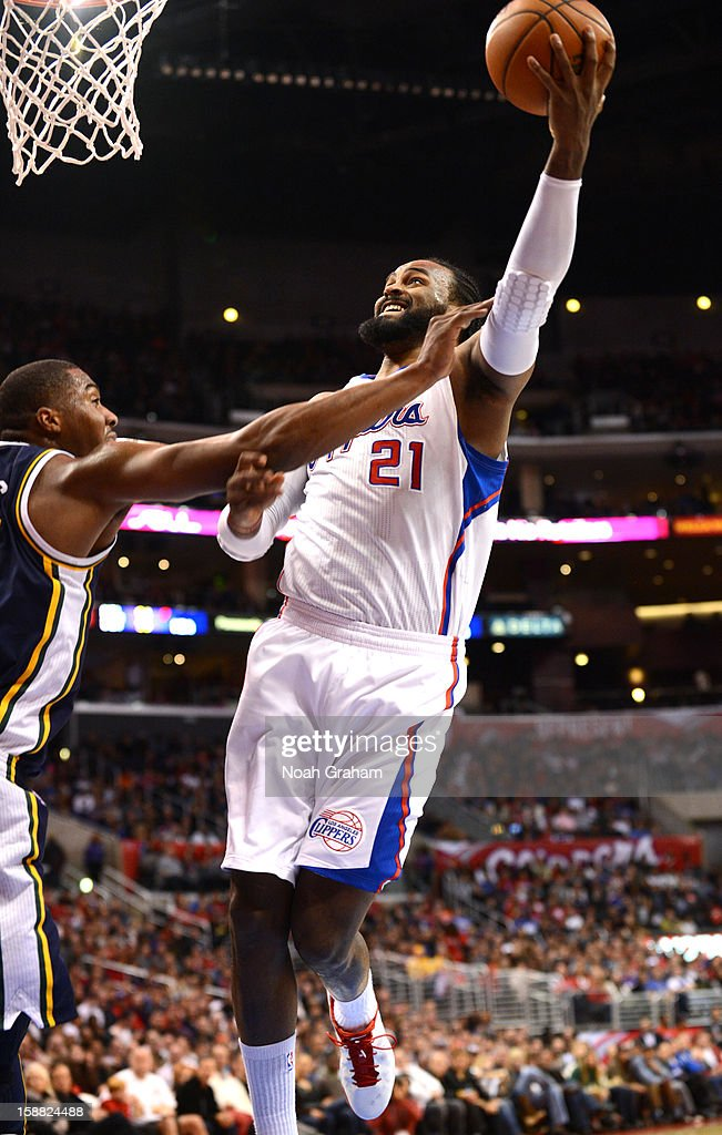 Ronny Turiaf #21 of the Los Angeles Clippers goes to the basket during the game between the Los Angeles Clippers and the Utah Jazz at Staples Center on December 30, 2012 in Los Angeles, California.