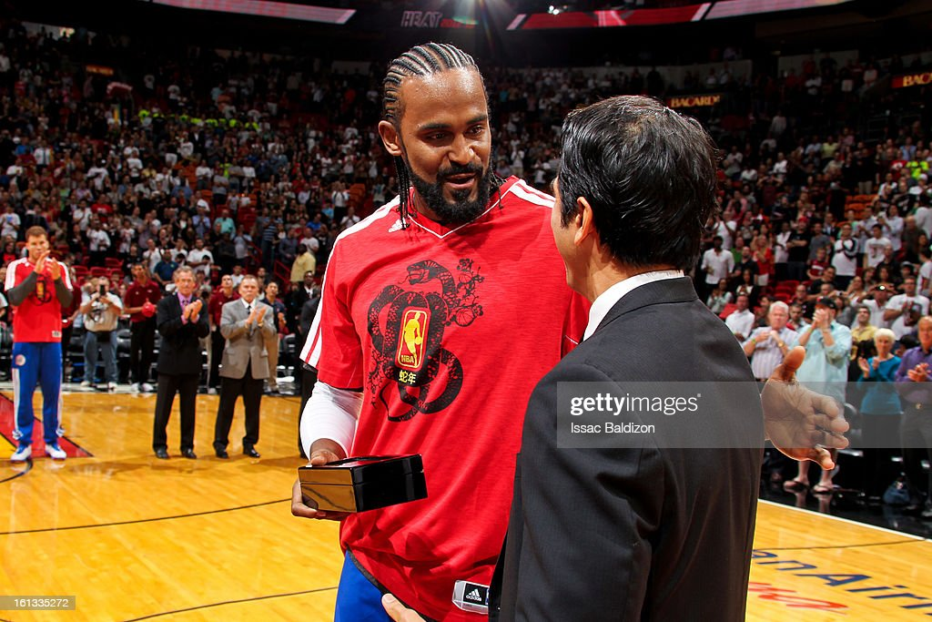 Ronny Turiaf #21 of the Los Angeles Clippers receives his Championship ring from former coach Erik Spoelstra of the Miami Heat before the two teams played on February 8, 2013 at American Airlines Arena in Miami, Florida.