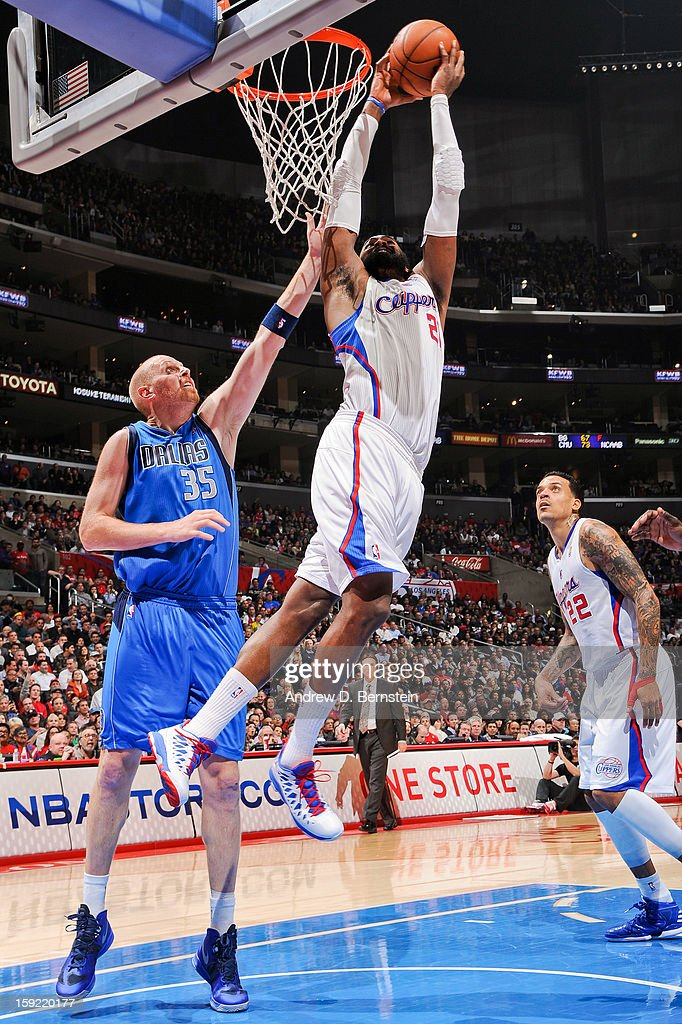Ronny Turiaf #21 of the Los Angeles Clippers rises for a dunk against Chris Kaman #35 of the Dallas Mavericks at Staples Center on January 9, 2013 in Los Angeles, California.