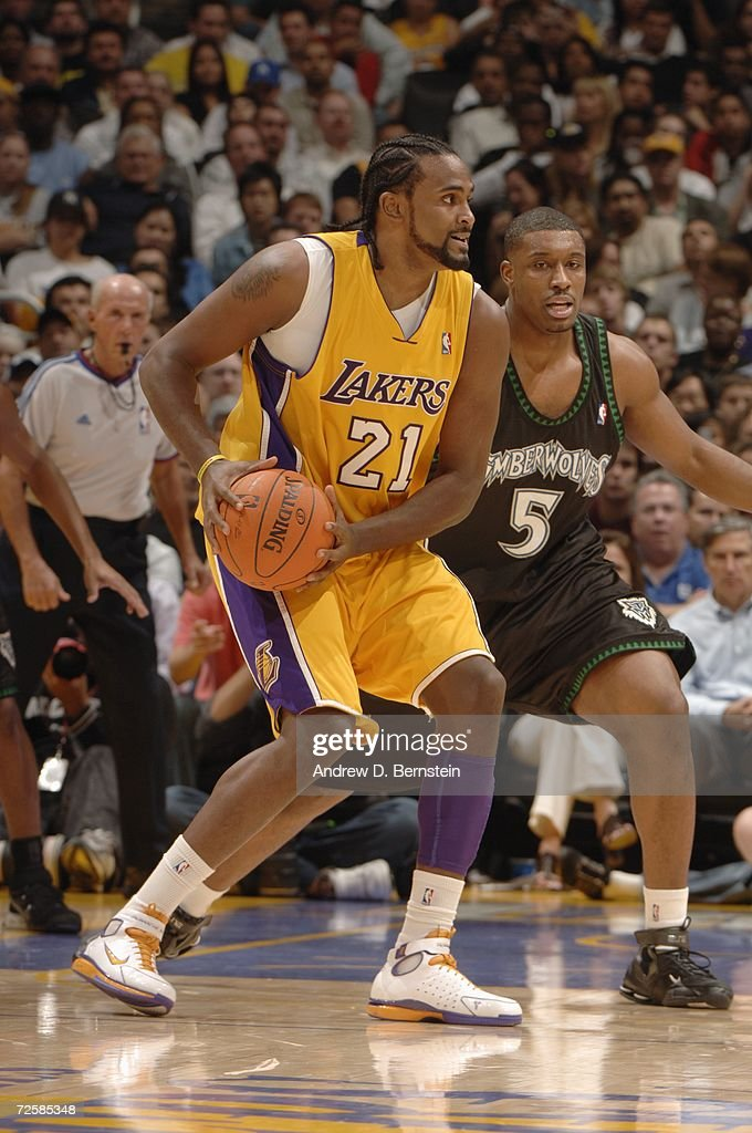 Ronny Turiaf of the Los Angeles Lakers looks to move the ball against Craig Smith of the Minnesota Timberwolves during a game at Staples Center on...