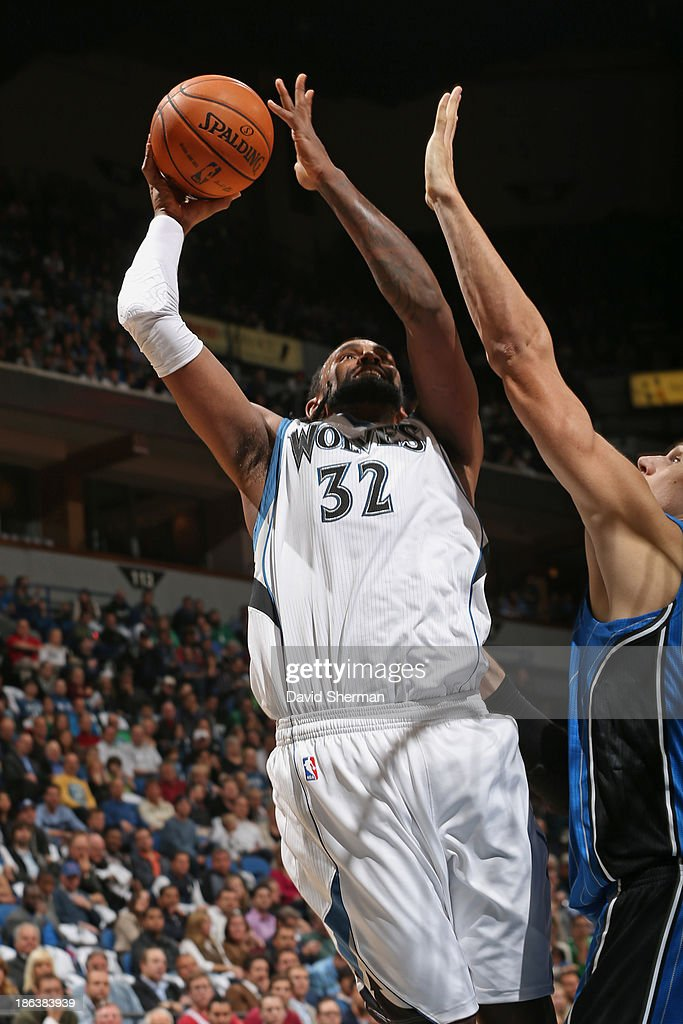 Ronny Turiaf #32 of the Minnesota Timberwolves drives to the basket against the Orlando Magic during the season and home opening game on October 30, 2013 at Target Center in Minneapolis, Minnesota.