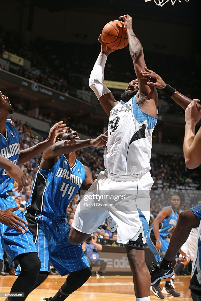 Ronny Turiaf #32 of the Minnesota Timberwolves grabs a rebound against the Orlando Magic during the season and home opening game on October 30, 2013 at Target Center in Minneapolis, Minnesota.