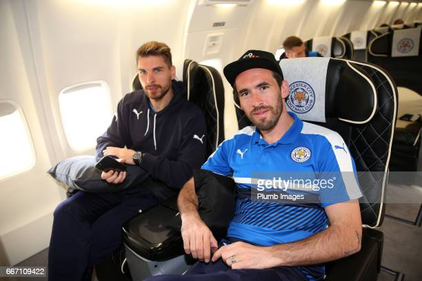 RonRobert Zieler and Christian Fuchs of Leicester City sit on board the plane from East Midlands Airport to Madrid for the Champions League Quarter...