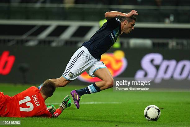 RonRobert Zieler of Germany fights for the ball with Jose Sosa of Argentina during the international friendly match between Germany and Argentina and...