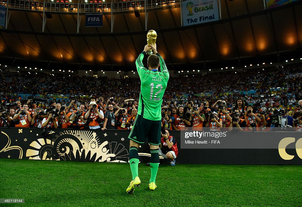 RonRobert Zieler of Germany lifts the World Cup after the 2014 FIFA World Cup Brazil Final match between Germany and Argentina at Maracana on July 13...