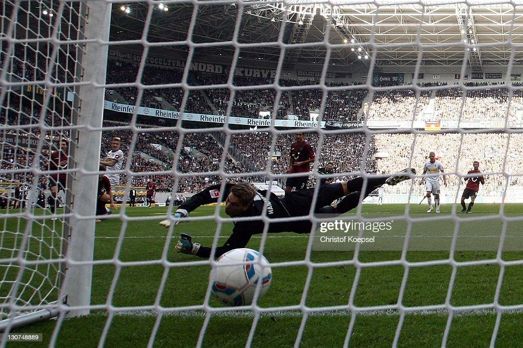 RonRobert Zieler of Hannover gets the first goal of Marco Reus of Moenchengladbach during the Bundesliga match between Borussia Moenchengladbach and...