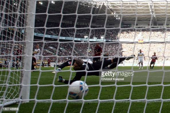 RonRobert Zieler of Hannover gets the first goal of Marco Reus of Moenchengladbach during the Bundesliga match between Borussia Moenchengladbach and...
