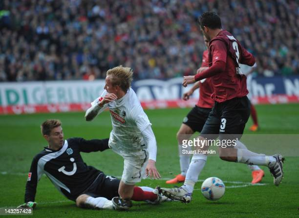 RonRobert Zieler of Hanover makes a save from Jan Rosenthal of Freiburg during the Bundesliga match between Hannover 96 and SC Freiburg at AWD Arena...