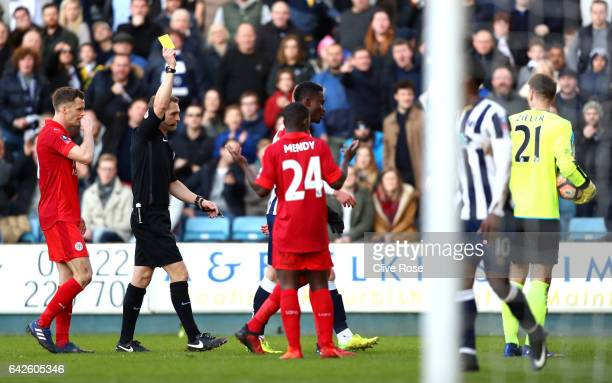 RonRobert Zieler of Leicester City is shown a yellow card during The Emirates FA Cup Fifth Round match between Millwall and Leicester City at The Den...