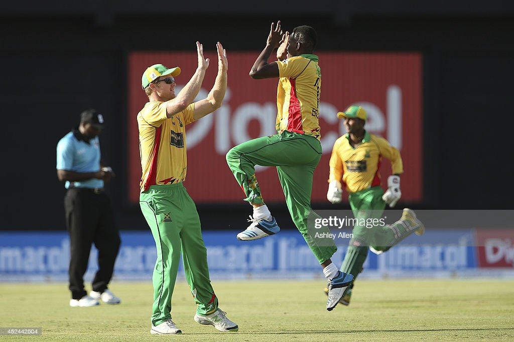 Ronsford Beaton and <a gi-track='captionPersonalityLinkClicked' href=/galleries/search?phrase=Jimmy+Neesham&family=editorial&specificpeople=6680337 ng-click='$event.stopPropagation()'>Jimmy Neesham</a> celebrate during a match between Guyana Amazon Warriors and Jamaica Tallawahs as part of the week 2 of Caribbean Premier League 2014 at Providence Stadium on July 20, 2014 in Georgetown, Guyana.