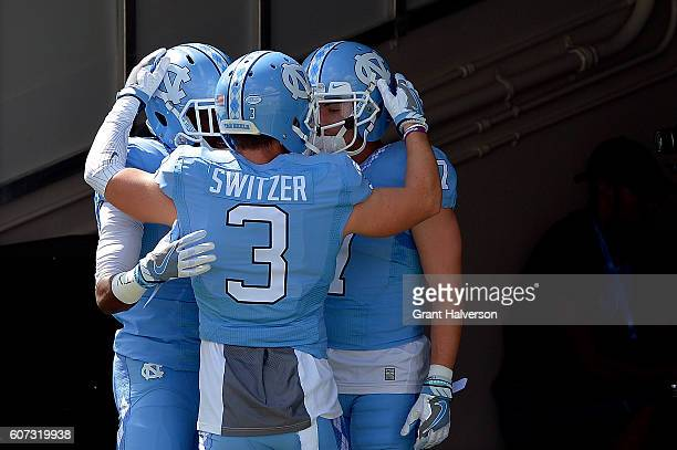 Rontavius Groves Ryan Switzer and Austin Proehl of the North Carolina Tar Heels huddle before the game against the James Madison Dukes at Kenan...