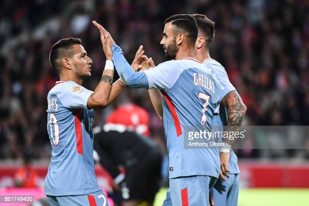 Rony Lopes celebrates a goal with Rachid Ghezzal of Monaco during the Ligue 1 match between Lille OSC and AS Monaco at Stade Pierre Mauroy on...