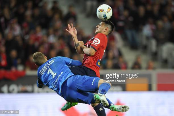 Rony Lopes of Lille and Karl Johan Johnsson of Guingamp during the Ligue 1 match between Lille OSC and EA Guingamp at Stade PierreMauroy on April 22...