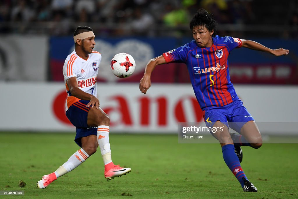 Rony (L) of Albirex Niigata and Yuichi Maruyama of FC Tokyo compete for the ball during the J.League J1 match between FC Tokyo and Albirex Niigata at Ajinomoto Stadium on July 30, 2017 in Chofu, Tokyo, Japan.