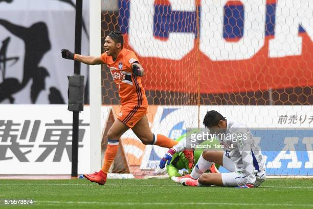 Rony of Albirex Niigata celebrates his side's first goal scored by Eder Lima of Ventforet Kofu during the JLeague J1 match between Albirex Niigata...