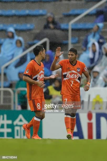 Rony of Albirex Niigata celebrates scoring the opening goal with his team mate Kei Koizumi during the JLeague J1 match between Jubilo Iwata and...