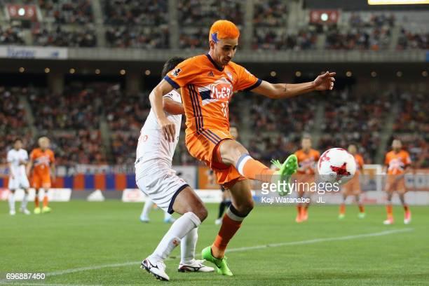 Rony of Albirex Niigata controls the ball under pressure of Hiroyuki Komoto of Omiya Ardija during the JLeague J1 match between Albirex Niigata and...