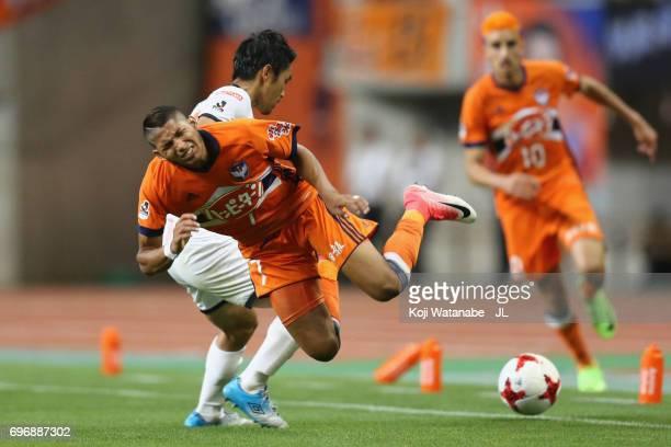 Rony of Albirex Niigata is challenged by Daisuke Watabe of Omiya Ardija during the JLeague J1 match between Albirex Niigata and Omiya Ardija at Denka...