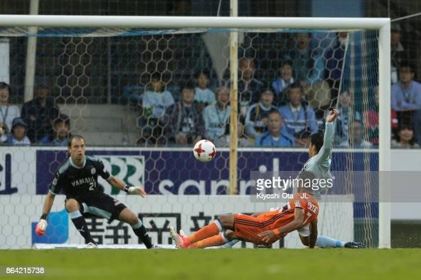 Rony of Albirex Niigata scores the opening goal during the JLeague J1 match between Jubilo Iwata and Albirex Niigata at Yamaha Stadium on October 21...