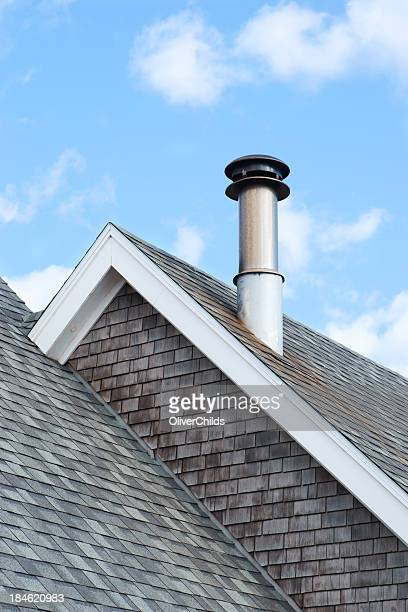 Roof apex with chimney.