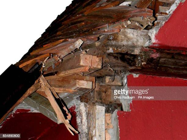 Roof damage on the 500yearold Tudor home of wood carver Wynn Evans in Cavendish Suffolk after a lorry knocked an oak roof beam off the side of it on...