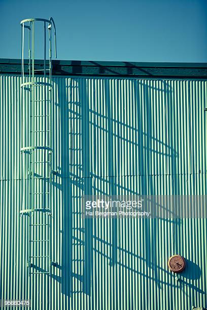 Roof Ladder and Shadow on Corrugated Metal