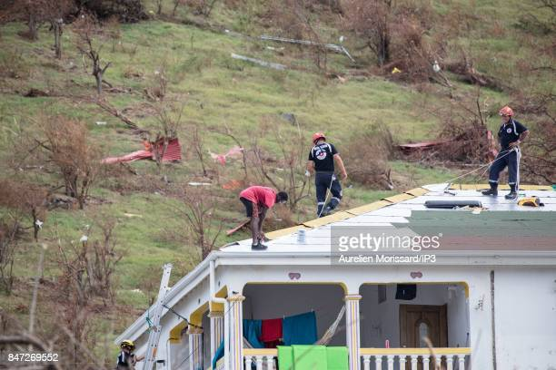Roof repairs begin with the help of the French Catastrophe Relief Group nine days after the passage of hurricane IRMA on September 14 2017 in...