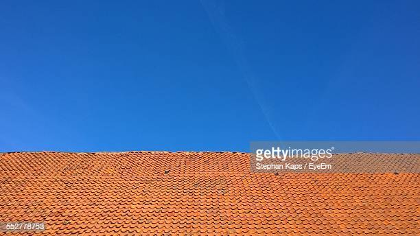 Roof Tiles Against Clear Blue Sky
