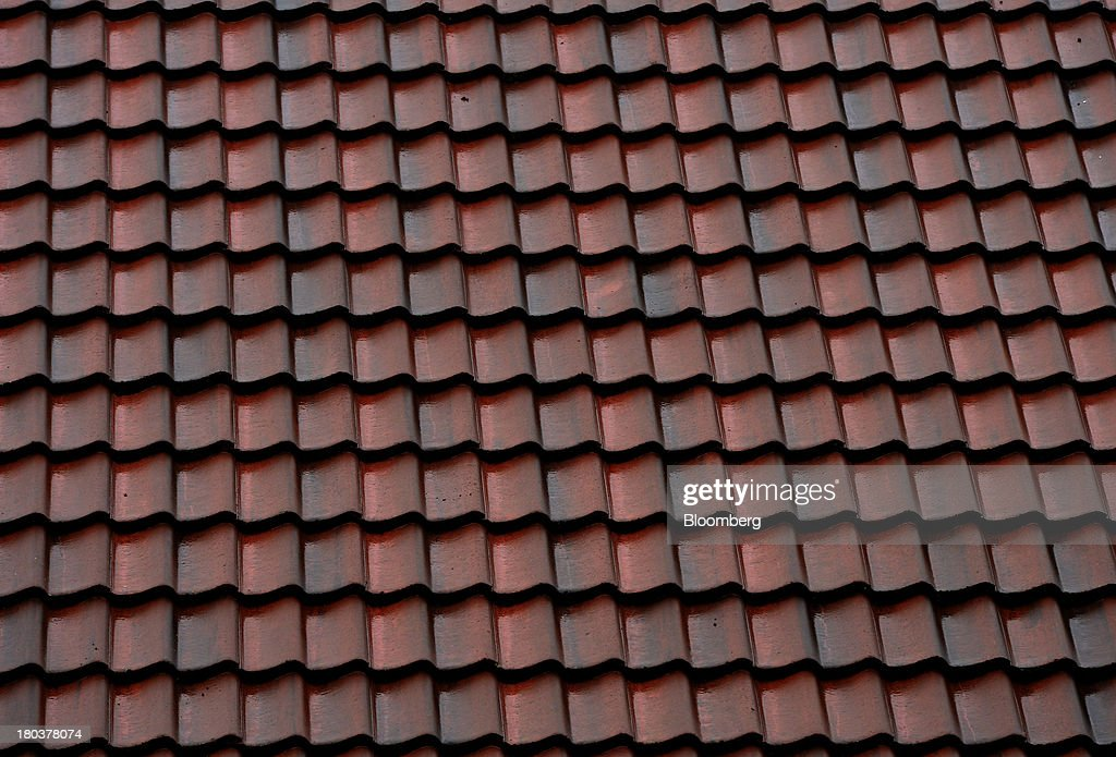 Roof tiles sit on a residential property in Newcastle-upon-Tyne, U.K., on Wednesday, Sept. 11, 2013. U.K. house prices rose for a seventh month in August and will probably continue to increase through the rest of the year, according to a report by Halifax. Photographer: Nigel Roddis/Bloomberg via Getty Images