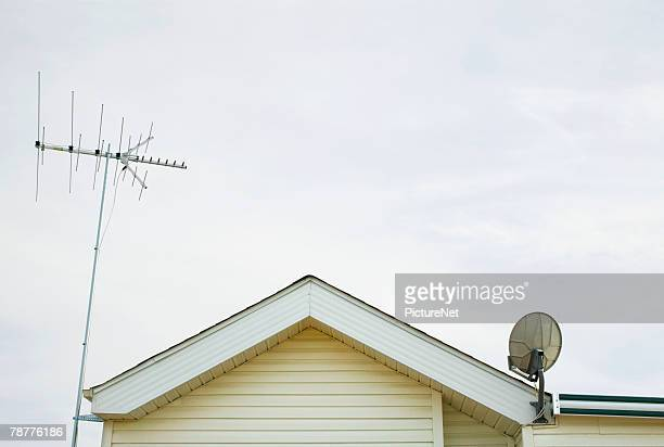 Roof with TV Antenna and Satellite Dish