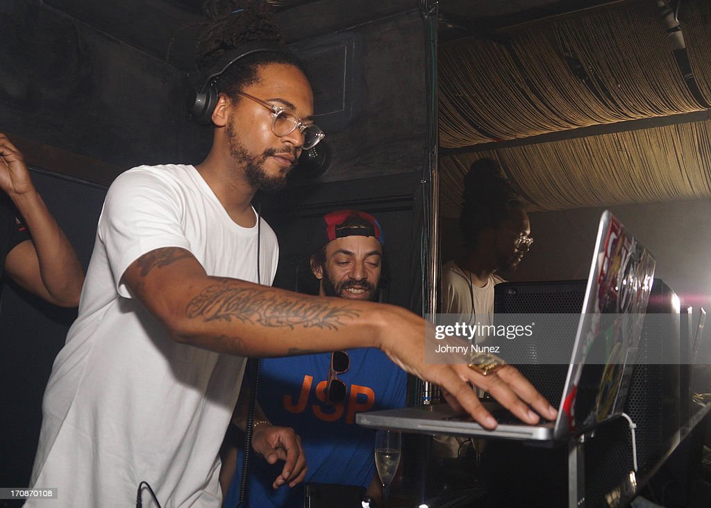 DJ Roofeeo (L) spins during GetLive! at Lil Charlie's on June 18, 2013 in New York City.