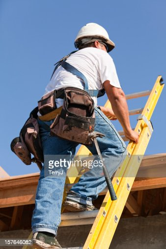 Roofer Climbs Ladder to Get on Top of Home