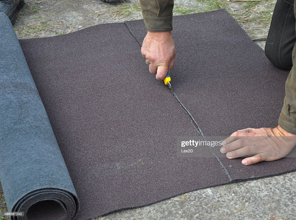 Roofer Cutting Roll Roofing Felt Or Bitumen During Waterproofing Works. :  Stock Photo