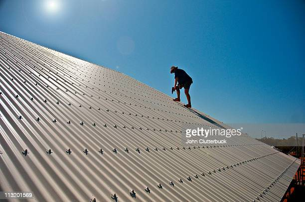 Roofer on tin roof