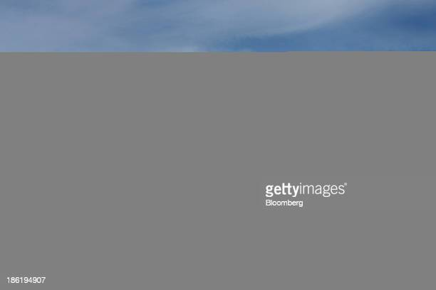 Roofers work on an oceanfront home on Long Beach Island in Long Beach Township New Jersey US on Thursday Sept 26 2013 Long Beach Township is one of...