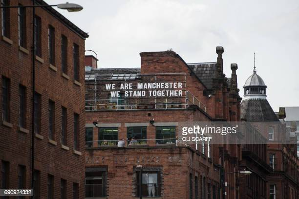 A rooftop sign displays a message of defiance to the terror attack of May 22 at the Manchester Arena in Manchester northwest England on May 31 2017 /...