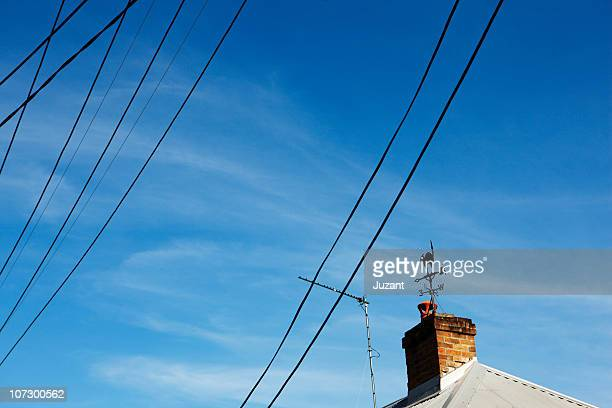 Rooftop with wind vane and telephone wires