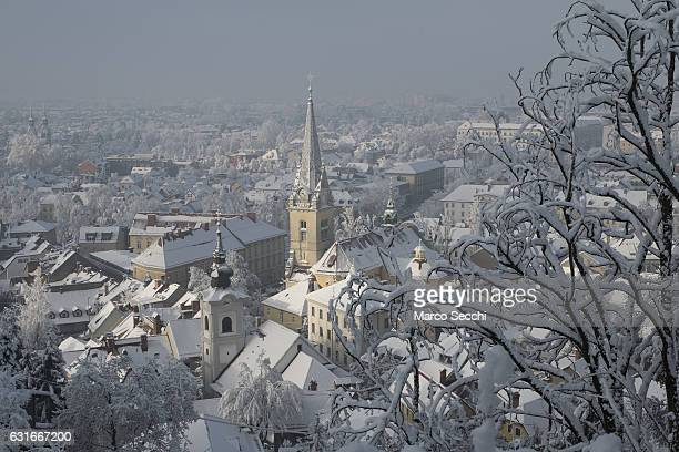 Rooftops are seen from the road towards the Castle on January 14 2017 in Ljubljana Slovenia Most of Slovenia was covered by heavy snowfalls for the...