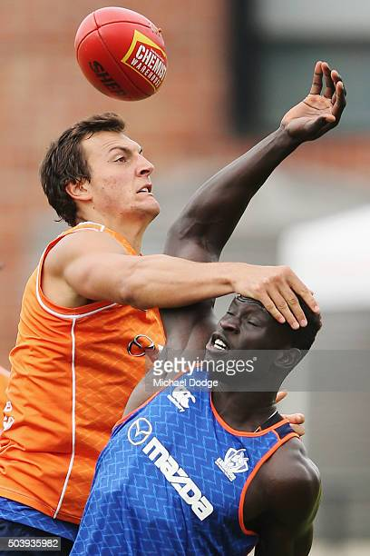 Rookie Braydon Preuss who played Rugby League until the age of 16 competes for the ball against Majak Daw during a North Melbourne Kangaroos AFL...