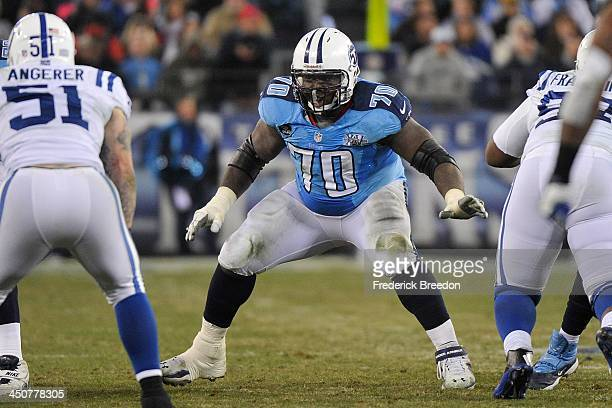 Rookie Chance Warmack of the Tennessee Titans blocks against the Indianapolis Colts at LP Field on November 14 2013 in Nashville Tennessee