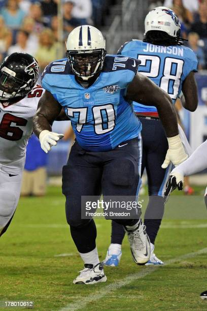 Rookie Chance Warmack of the Tennessee Titans plays during a preseason game against the Atlanta Falcons at LP Field on August 24 2013 in Nashville...