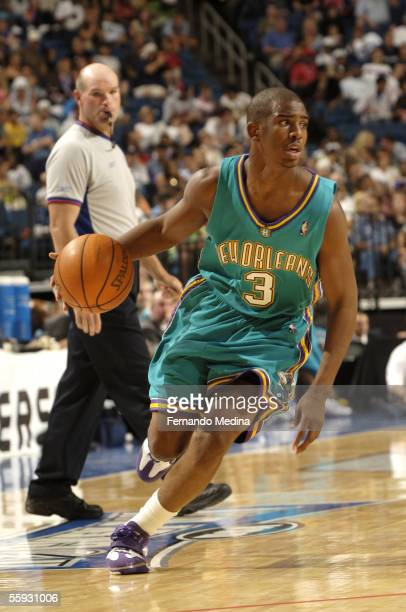 Rookie Chris Paul of the New Orleans/Oklahoma City Hornets dribbles against the Orlando Magic during a preseason game at St Pete Times Forum on...