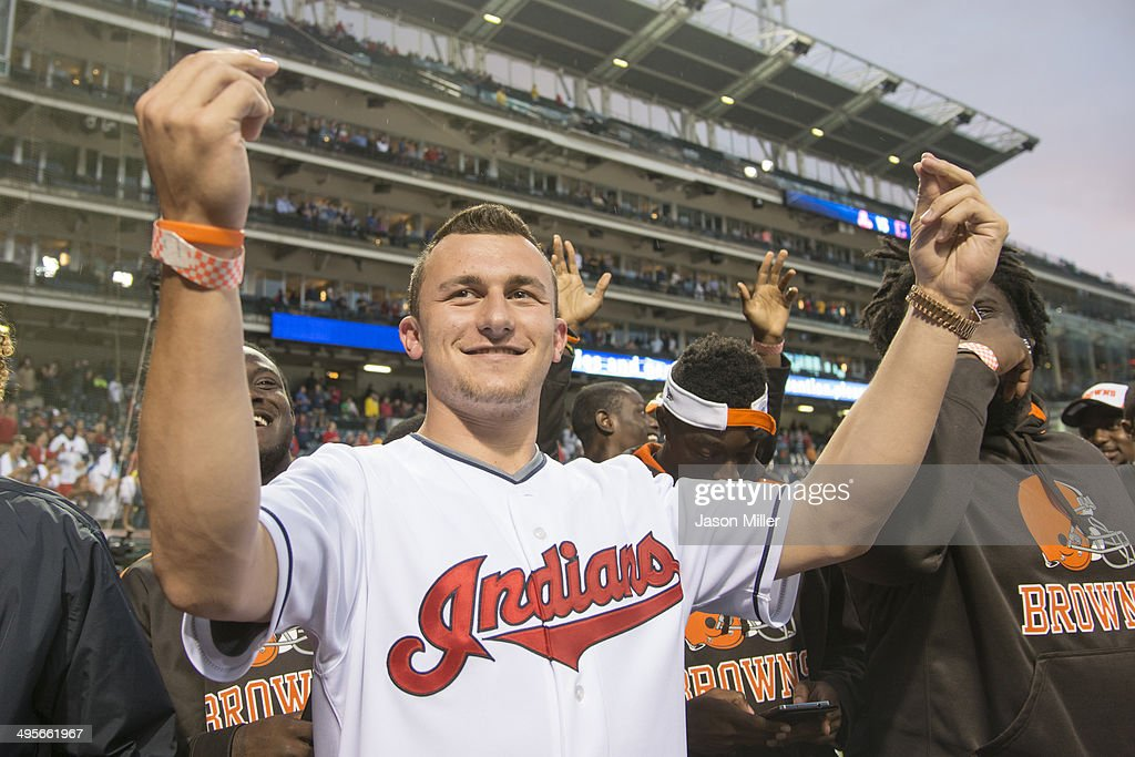 Rookie draft pick <a gi-track='captionPersonalityLinkClicked' href=/galleries/search?phrase=Johnny+Manziel&family=editorial&specificpeople=9703372 ng-click='$event.stopPropagation()'>Johnny Manziel</a> of the NFL Cleveland Browns acknowledges the crowd prior to the game between the Cleveland Indians and the Boston Red Sox along with other Brows rookies at Progressive Field on June 4, 2014 in Cleveland, Ohio.