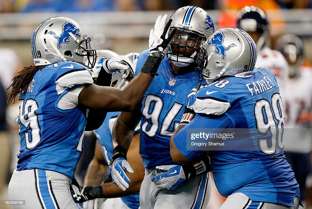 Rookie Ezekiel Ansah #94 of the Detroit Lions celebrates with teammates Willie Young #79 and Nick Fairley #98 while playing the Chicago Bears at Ford Field on September 29, 2013 in Detroit, Michigan.