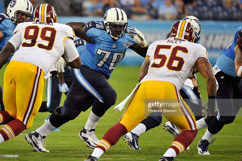 Rookie guard Chance Warmack #70 of the Tennessee Titans plays against Perry Riley #56 of the Washington Redskins during a pre-season game at LP Field on August 8, 2013 in Nashville, Tennessee.