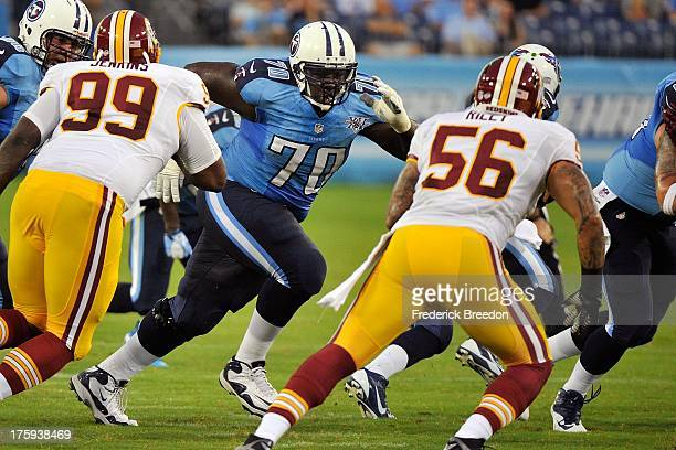 Rookie guard Chance Warmack of the Tennessee Titans plays against Perry Riley of the Washington Redskins during a preseason game at LP Field on...