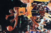 Rookie Kobe Bryant of the Los Angeles Lakers flies through the air as he drives to the basket during the first half 26 March game against the...
