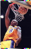 Rookie Kobe Bryant of the Los Angeles Lakers slamdunks two of his 21 points 03 January during the second half of their game against the Sacramento...
